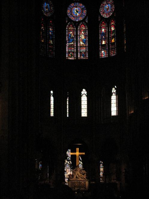 Inside Notre Dame. It felt like an eternal (yet spiritually soothing) night, and the cross beckoned to me with its cold glow to take a picture. I gave in.